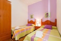 dormitorio-dos-camas-violeta-armario
