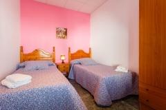 dormitorio-camas-rosa