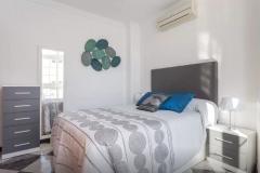 dormitorio-gris-blanco