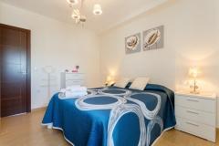 dormitorio-matrimonio-azul